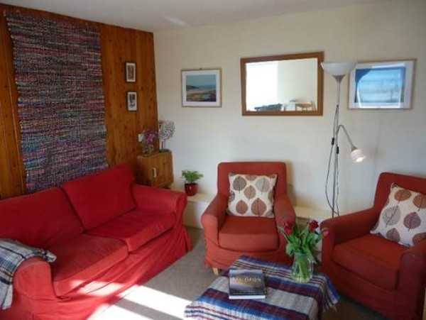 The sitting room in the Flat. The windows behind overlook Loch Broom