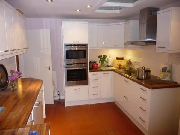The recently installed kitchen showing double oven and integrated microwave.
