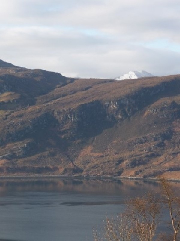 The view across the Loch, with the peak of An Teallach showing the in background