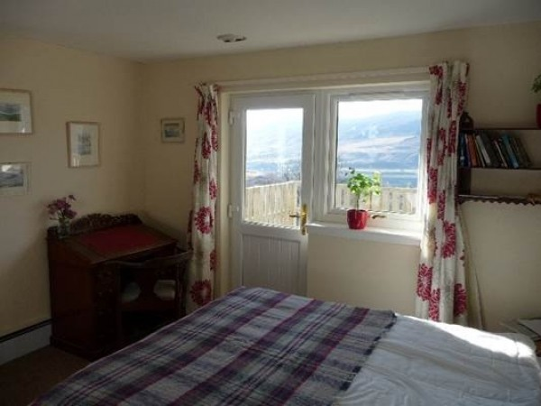 The master bedroom with balcony overlooking Loch Broom