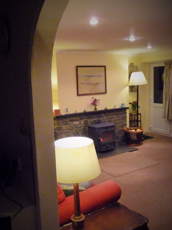 The sitting room with a wood burning stove